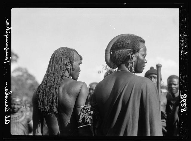 Tanganyika. Arusha. Masai men wearing peculiar wigs