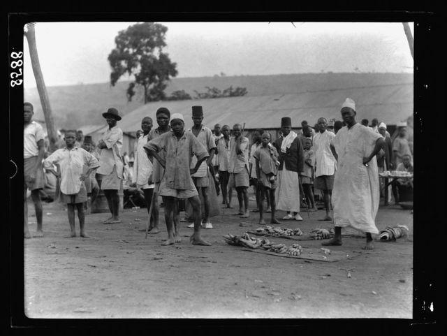 Tanganyika. Dar-es-Salem. Youths in a native market