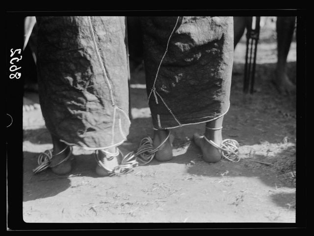 Tanganyika. En route to Longido. Woman's leg bangles. Close up