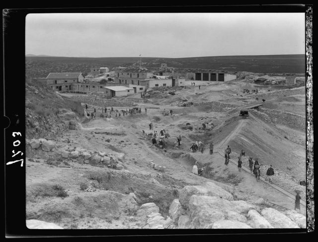 Tel Deweir (Lachish). Camp buildings at Tell. Workers clearing area below flanking wall