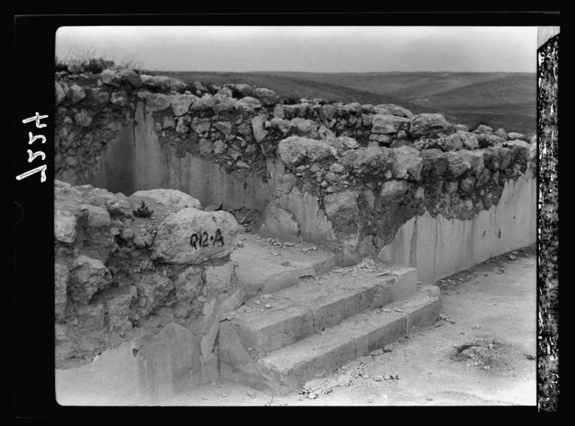 Tel Deweir (Lachish). Close view of 3 steps backing into sanc. [i.e., santuary] of solar shrine, Persian pd [i.e., period]. In axis of doorway is a small hole pierced thru plastered floor, possible libations made here