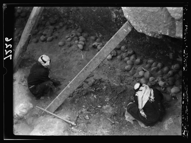 Tel Deweir (Lachish). Deposit of skulls on floor of tomb 120 being cleared. Date of burials 1400 B.C. Chamber used for dwelling & reused as repository for salvaged human remains