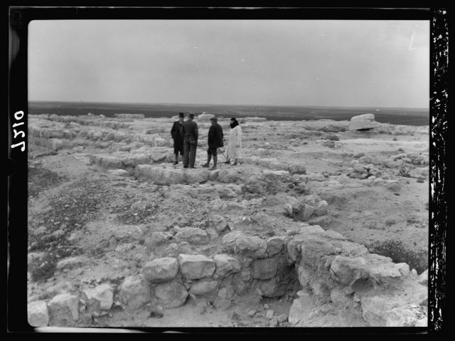 Tel Deweir (Lachish). Jewish palace-fort on crest. Column base and stone door thresholds of later Persian building visible right and center of pic[ture]