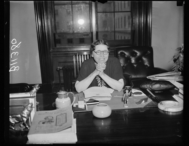 The lady from Arkansas, Washington, D.C., Oct. 8. Fit and ready for the opening of the next session of Congress, Senator Hattie W. Caraway, of Arkansas, poses for the cameraman at her desk today