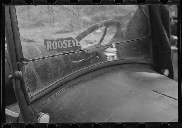 The windshield of a migratory agricultural laborer's car, in a squatter camp near Sacramento, California