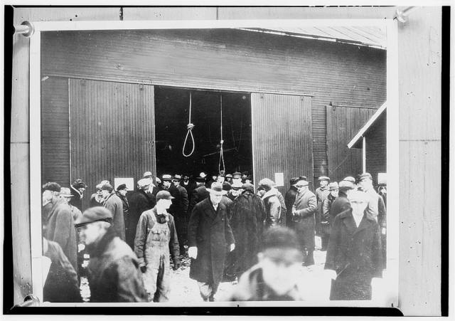 Two hangman's nooses hang as a grim warning to prospective bidders on this foreclosed farm. In this way many farms sold for only a few cents until the Farm Debt Adjustment Committee came into being