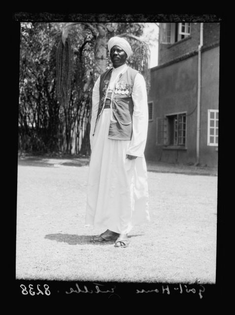 Uganda. Entebbe. Government house from across the lawn. Nubian guard close up