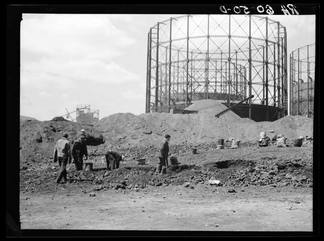 Unemployed men salvaging coke from industrial cinder pile at Milwaukee Railroad shops. Wisconsin