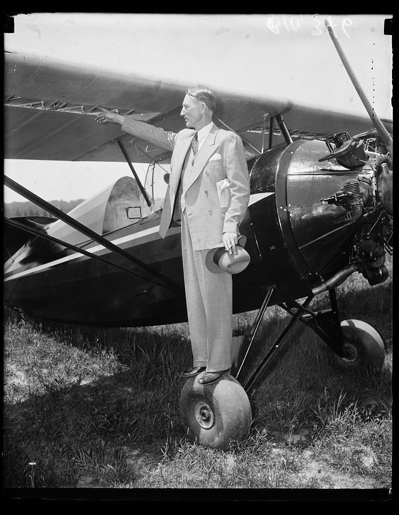 [Unidentified man and airplane]