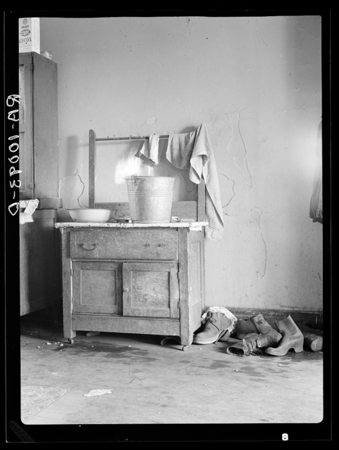 Washstand in corner of kitchen of Edgar Allen's home on farm near Milford, Iowa. Contrast this with washstand picture of Harry Madsen farm, tenant house