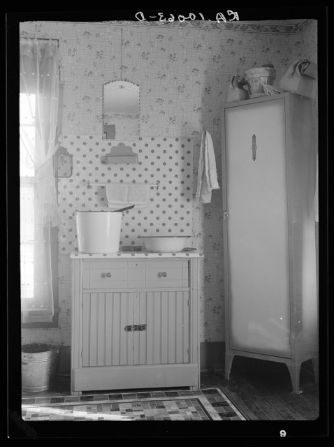 Washstand in house occupied by married hired hand and his wife. Harry Madsen farm near Dickens, Iowa. Three hundred sixty acres, owner-operated