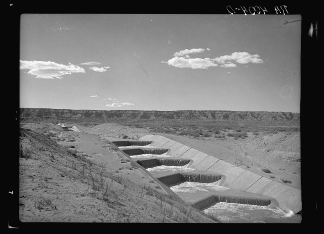 Water from the Rio Grande flowing through an irrigation canal. Sierra County, New Mexico