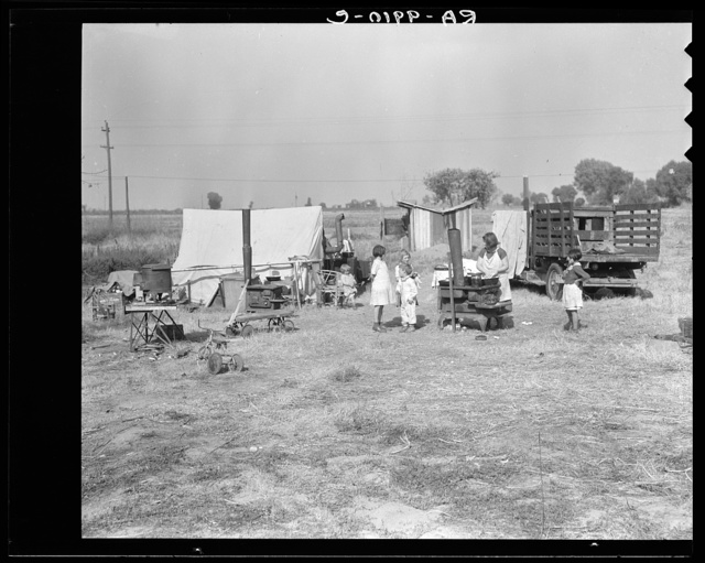 "Wife and five children of migratory fruit worker. American River camp on outskirts of Sacramento, California. Have worked in the fruit since 1931. ""We don't make a living, but we live on what we make"""