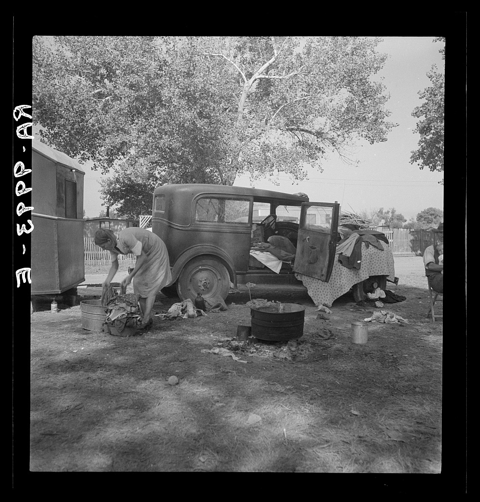 Wife of migratory worker in auto camp. California