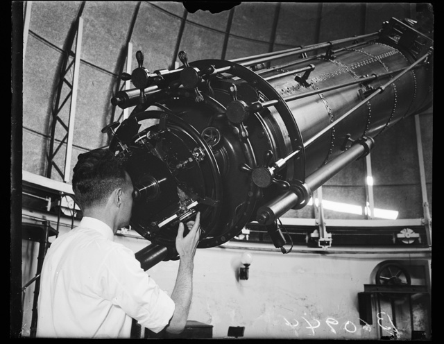 William Browner, Ast. Astronomer at the Naval Obs. looking thru 25 inch reflectuary teles.