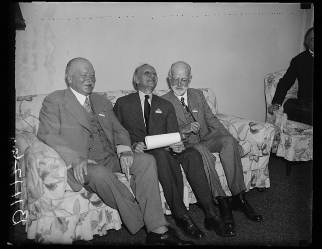 World I over officials, Washington, D.C. Sept. 7. The leaders of the Third World Power Conference held a meeting in the morning to discuss some of the details of the meeting. Photo shows, left to right: Julius Dorppuller of Germany, President of the Conference, Director O.C. Morill acting as host, and Dr. Wm. F. Durand who is acting as General Chairman at the Conference