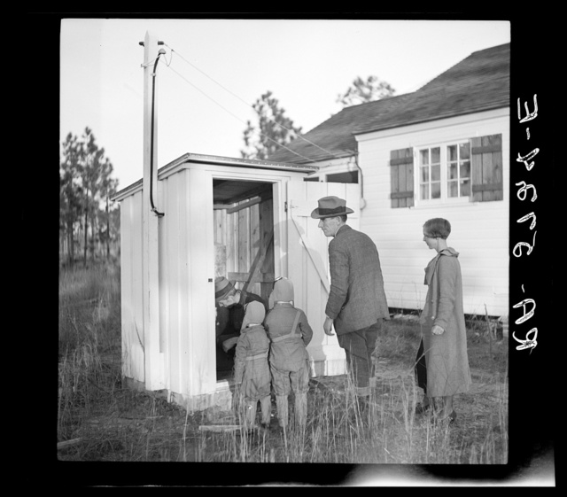 W.R. Hubbard and family inspecting pumphouse at their new home on the Penderlea Homesteads, North Carolina
