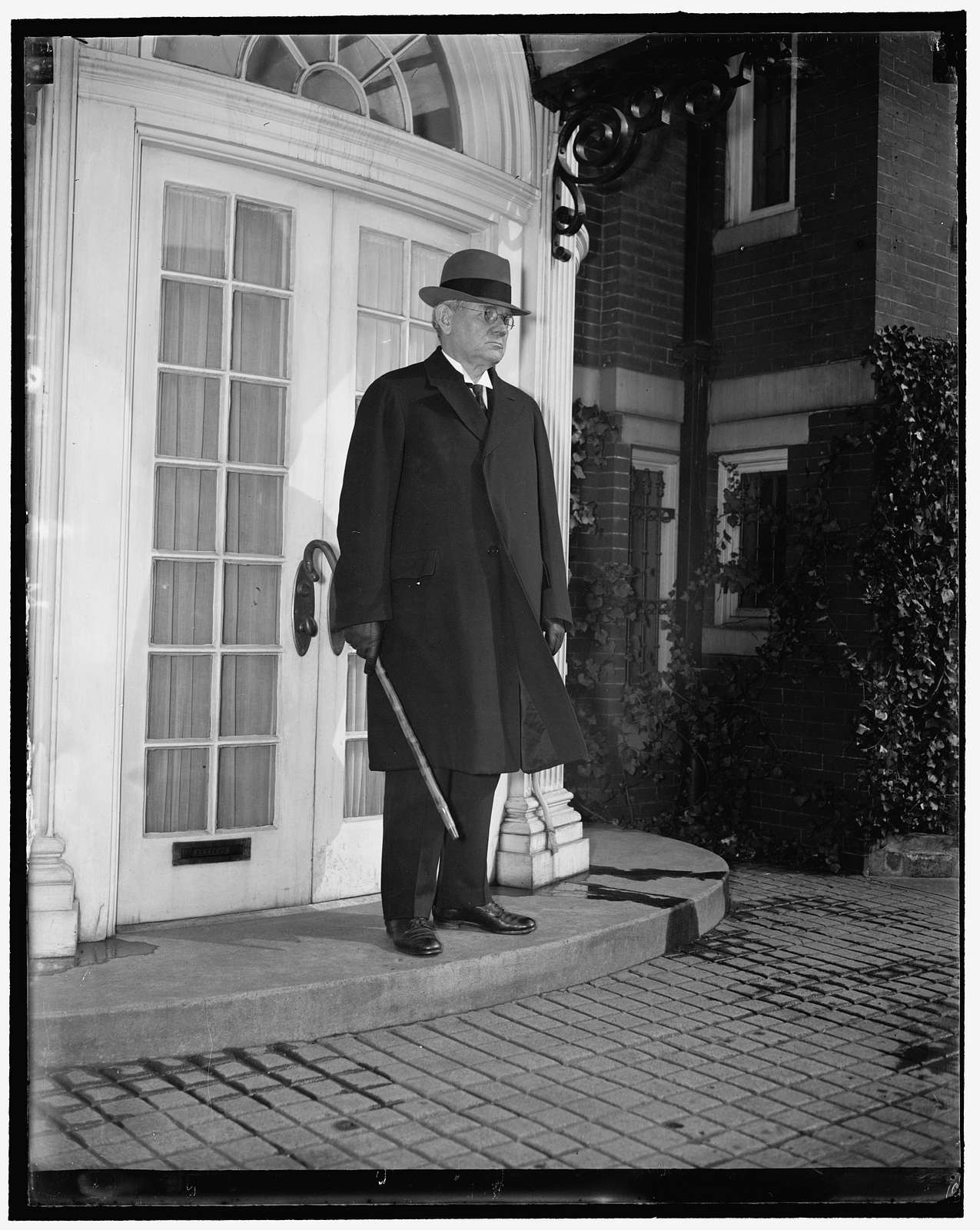 """""""71"""" on St. Patrick's Day. Washington, D.C., March 17. Justice Pierce Butler, 71 years old today celebrates his birthday by taking his morning walk, snapped while leaving his home on 19th St. altho the Supreme Court is in 2 weeks recess Justice Butler continues his work on Supreme Court cases at home.."""