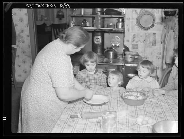 7:45 a.m. Tip Estes' children watch their mother make a pie. Near Fowler, Indiana