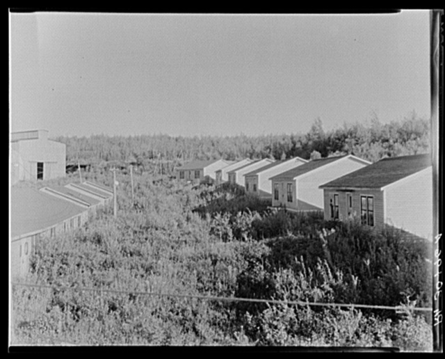 Abandoned miners' houses at Babbitt, Minnesota. Mine has not operated since about 1925, but still is kept in repair with remote prospect of opening at some future date