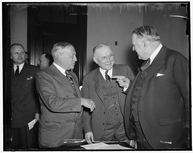 "A.F. of L. Head endorses Wagner Housing Bill. Washington, D.C., April 14. President William Green of the A.F. of L. discusses various phases of the Wagner $1,040,000,000 Housing Bill with Senator Robert F. Wagner (left) author of the bill, and Senator David [...] Walsh, Chairman of the Senate Subcommittee on Education and Labor. Green appeared before the Committee today to give his endorsement of the bill. Besides believing unemployment and eliminating slums, the measure will provide low-rent housing for the workers of the country in order that their purchasing power may not be curtailed as rents rise under an ""acute"" housing shortage, Green told the Committee, 4/14/1937"