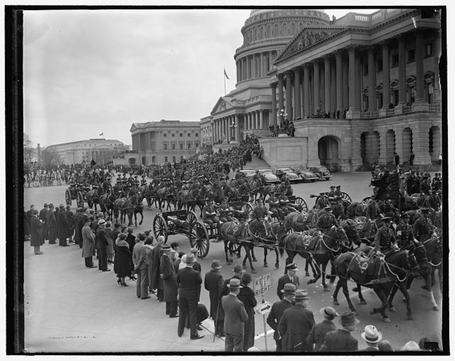 Army Day in Capital. Washington, D.C., April 6. A colorful peacetime parade marked the Capital's 10th celebration of Army Day and the 20th anniversary of the day America entered into the World War. This picture was made as the parade passed the Capitol where it was reviewed by both Houses of Congress, 4/6/1937