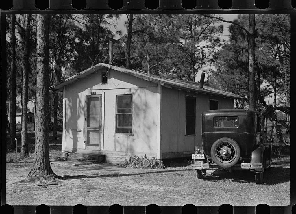 Auto and temporary home of a migratory fruit worker near Winter Haven, Florida