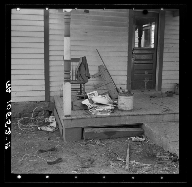 Backporch of Charles Miller's farmhouse during moving operations. Miller, for twelve years a hired farmhand, has now rented a farm to work for himself near Fowler, Indiana