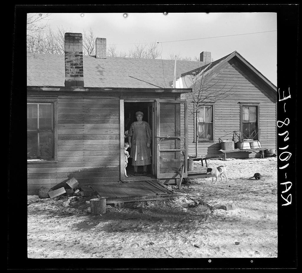 Backyard of James Simmons' farmhouse which he rents from an insurance company. Simmons is a tenant farmer with ten children. Near Marseilles, Illinois