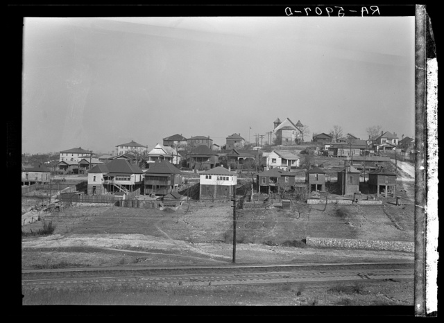 Backyards and house in Birmingham, Alabama, district from which have come some of the residents of the housing project