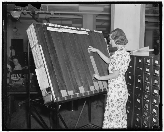 Baltimore, Md. For each block of 1,000 social security account applications 'work' cards are prepared. One work card is made for each operation incident to seeting up individual accounts and necessary indexes. The photograph above shows a worker in the Social Security Board Records Office at work at the 'visible control' rack. Each card in this rack represents an operation completed on one block[?] of applications. By glancing at each compartment in the rack, the number of operations completed can be estimated at once