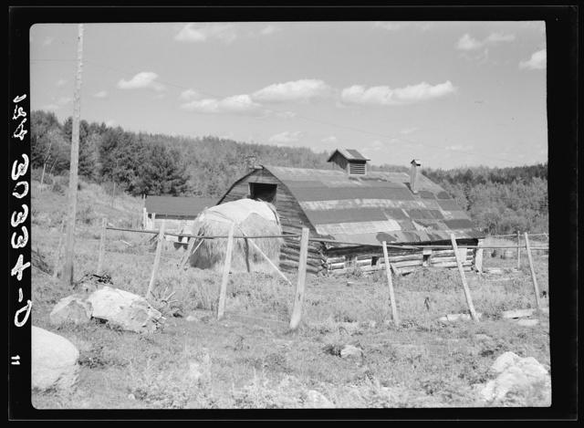 Barn and straw stack on cut-over farm near Winton, Minnesota