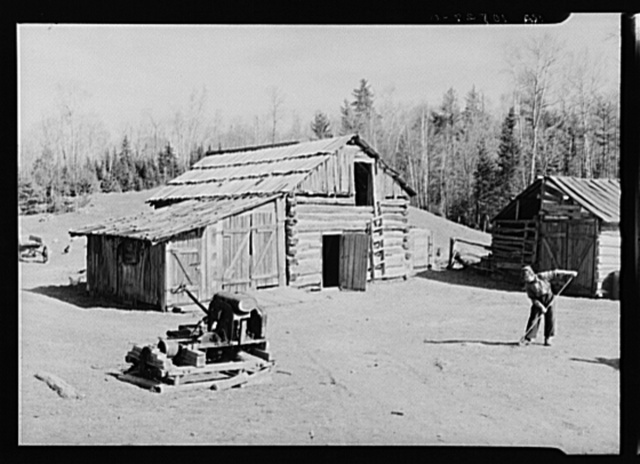 Barnyard of William Shanard, cut-over farmer in Michigan. Note portable sawmill made from a model-T Ford engine on sled