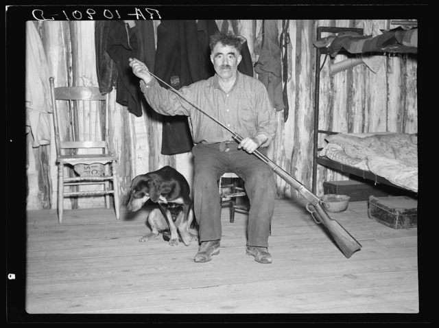 Black Aleck Dickinson and his dog Snoop. Iron County, Michigan