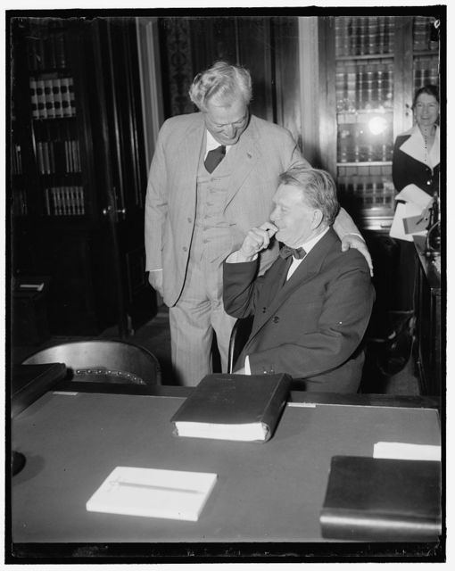 Borah and McCarran seem happy at Judiciary Committee. Washington, D.C., May 18. Sen. William E. Borah of Idaho (seated) and Senator Pat McCarran of Nevada, both seem elated that the Senate Judiciary Committee voted to report the President's bill to the Senate floor as unfavorable. Both of these Senators have been opposed to the bill and are glad that the meetings are over, 5/18/1937
