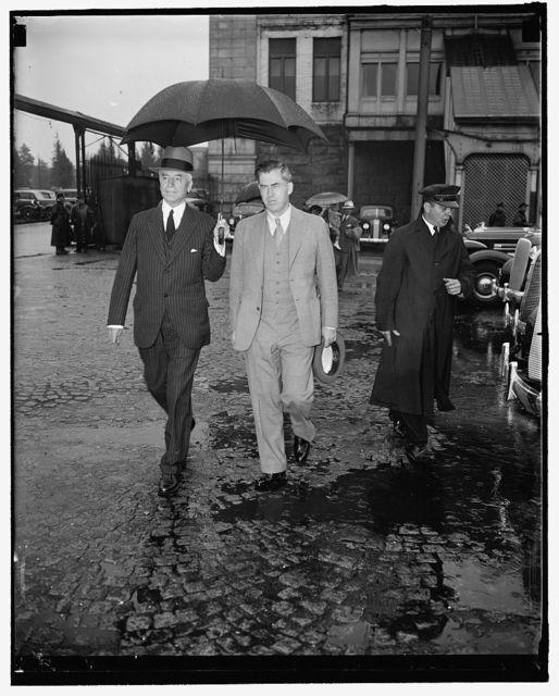 Cabinet member brave rain to greet chief. Washington, D.C., May 14. A heavy downpour didn't prevent members of the cabinet from greeting President Roosevelt on his return to the capital today. Here we see Secretary of State Cordell Hull (left) and Secretary of Agriculture Henry A. Wallace as they arrived at Union Station to greet the Chief, 5/14/1937