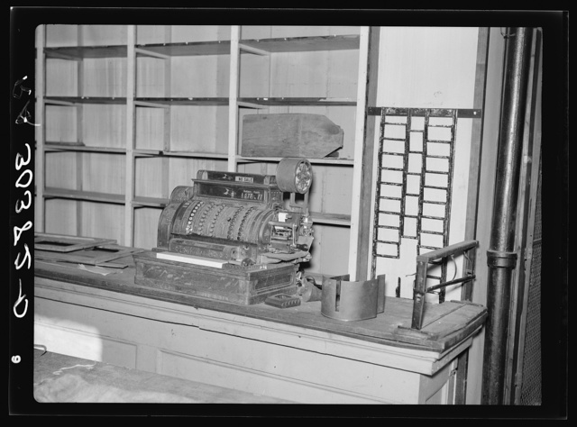 "Cash register and empty shelves in closed store. Babbitt, Minnesota, ""bust"" iron mining town"