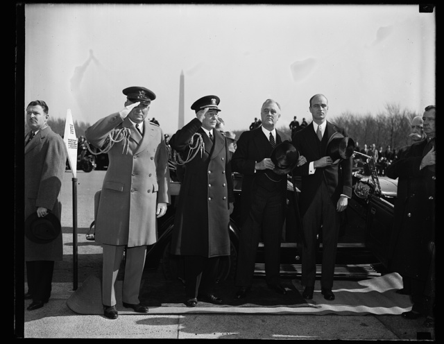 CHIEF EXECUTIVE ARRIVES AT LINCOLN MEMORIAL. WASHINGTON, D.C. FEBRUARY 12. PRESIDENT ROOSEVELT LED THE NATION TODAY IN PAYING HOMAGE TO THE MEMORY OF ABRAHAM LINCOLN WHEN HE ATTENDED APPROPRIATE CEREMONIES AT THE LINCOLN MEMORIAL.THE PRESIDENT IS SHOWN AS HE ARRIVED AT THE MEMORIAL WITH HIS SON JAMES HIS NAVAL AND MILITARY AIDES, COL. E. M. WATSON AND CAPT. PAUL BASTEDO