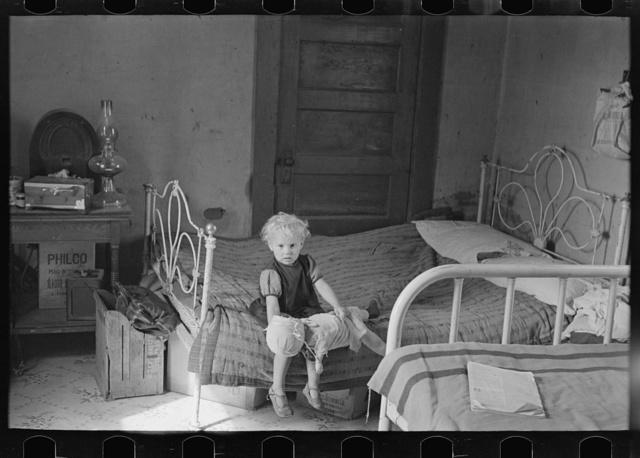 Child of Edwin Gorder in farmhouse bedroom, Williams County, North Dakota