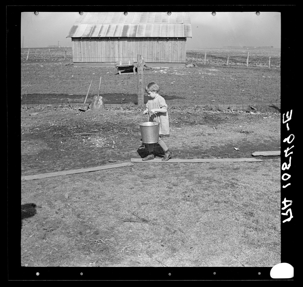 Child of Tip Estes, hired man near Fowler, Indiana, going after water