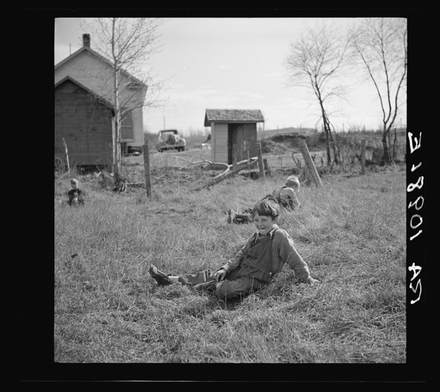 Children resting during recess at a rural school near Tipler, Wisconsin