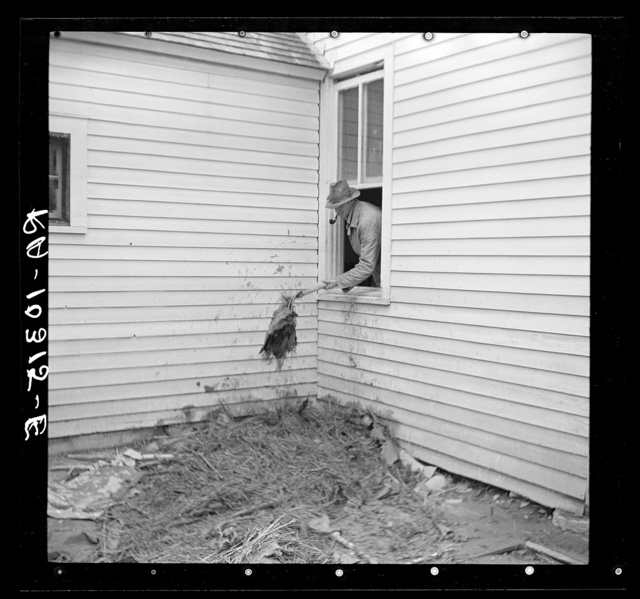Cleaning flood debris out of a farmhouse. Posey County, Indiana