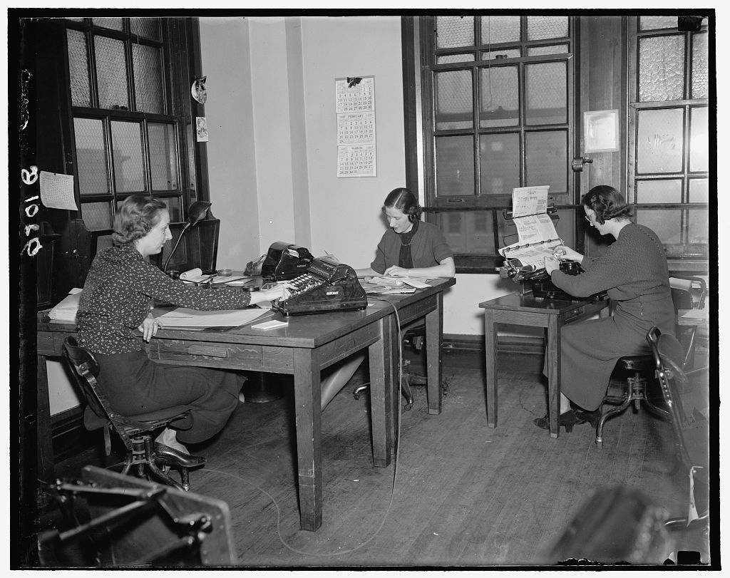 Clerks at the Reconstruction Finance Corporation computing interest on RFC loans