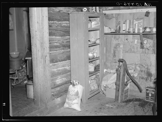 Corner of room occupied by the Smallwoods in a two-family shack near Alvin, Wisconsin. The pump does not work