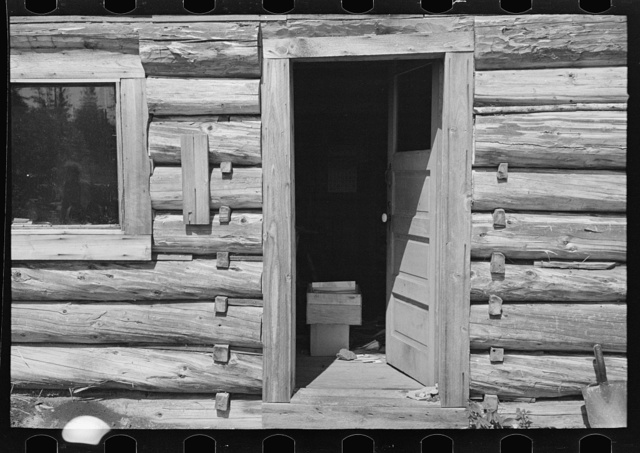 Detail of log cabin occupied by William Besson, mining prospector, near Winton, Minnesota