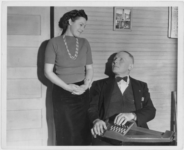 [Doc Davis of Bog Trotters Band, with autoharp, and unidentified woman, Galax, Virginia]