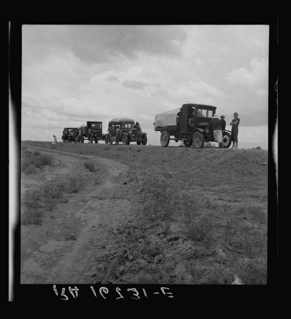 Drought refugee families from Oklahoma on road to Roswell, New Mexico, to chop cotton. Near Lordsburg, New Mexico