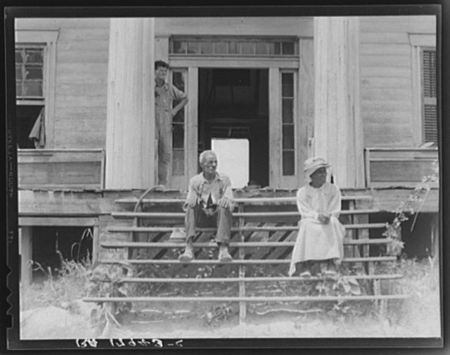 Ex-slave and wife on steps of plantation house now in decay. Greene County, Georgia