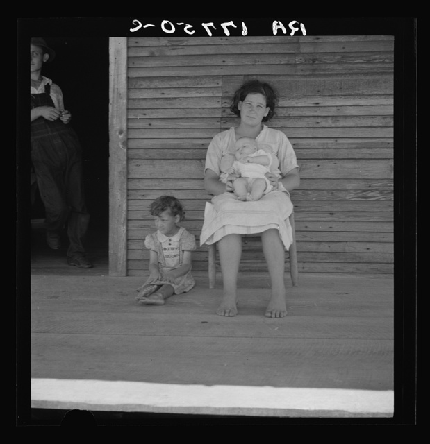 """Families are left stranded without means of support when the lumber mill """"cuts out."""" This family lives on a cut-over area. The mill has closed, and the father does WPA (Work Projects Administration) work. Near Kiln, Mississippi"""
