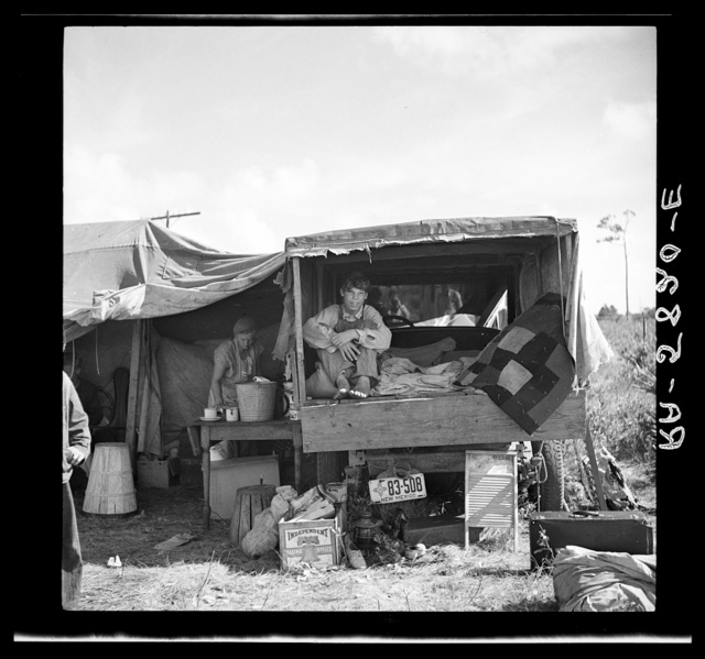 """Family from New Mexico, camped near the packinghouse at Deerfield, Florida. Note the box labeled """"Yakima apples"""" which has been carried all the way from the apple orchards of Washington"""